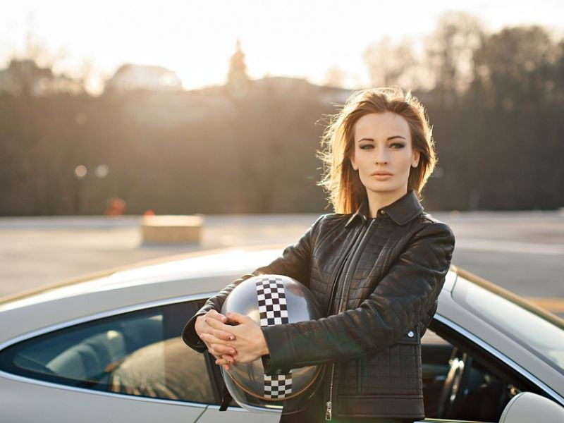 beautiful speed queen racer girl with her car