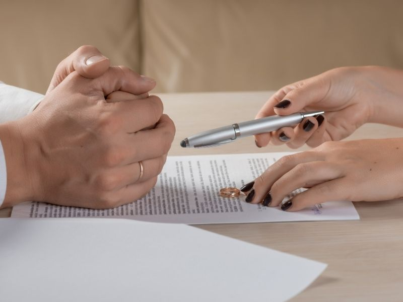 couple signing divorce documents